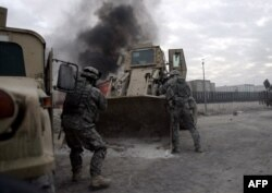 Increased troop numbers saw the United States make inroads against Al-Qaeda in Iraq between 2006 and 2008.