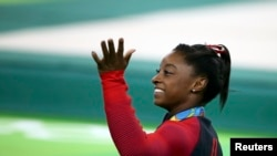 American gymnast Simone Biles took home a fourth gold medal from the Rio Olympics with a win in the women's floor competition.