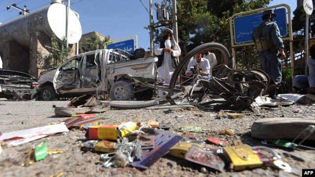 Locals inspect the site of a bomb explosion in Herat on August 15.