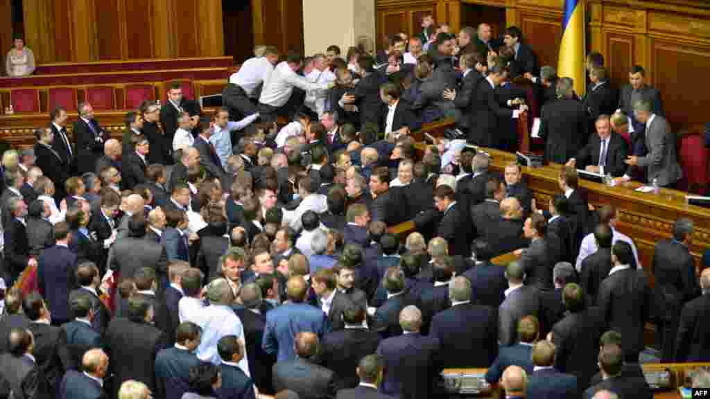 They might have been the first sessions of a new parliament, but Ukraine's lawmakers were back to their old ways on December 12 and 13 when melees on the chamber floor interrupted the proceedings.