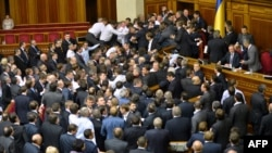 PHOTO GALLERY: Fistfights broke out in Ukraine's new parliament, the Verkhovna Rada, in successive sessions on December 12 and 13, as opposition lawmakers tried to block access to the podium following disputed elections and rumors of defections poisoning the air. (19 PHOTOS)