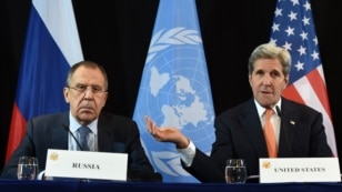 U.S. Secretary of States John Kerry (right) with Russian Foreign Minister Sergei Lavrov (left) during a press conference in Munich ahead of the international security conference.