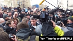 Opposition leader Boris Nemtsov is surrounded by cameras at the March 17 demonstration on Moscow's Pushkin Square.