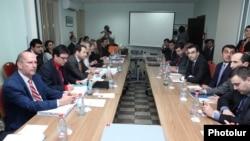 Armenia - EU (L) and Armenian officials begin a new round of free trade talks in Yerevan, 16Apr2013.