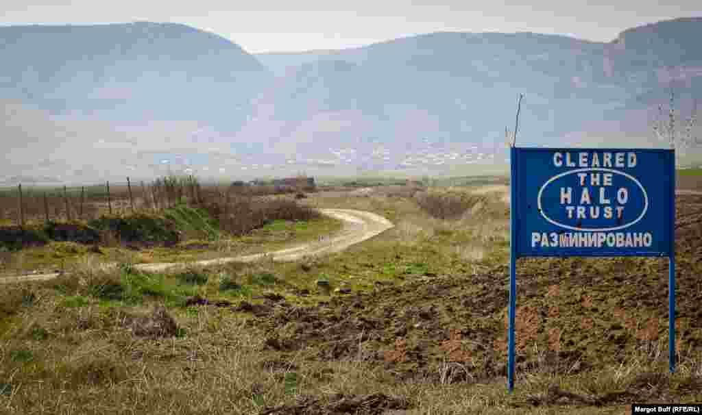 North of Stepanakert, a sign marks an area that has been cleared of land mines by a U.K.-based organization.