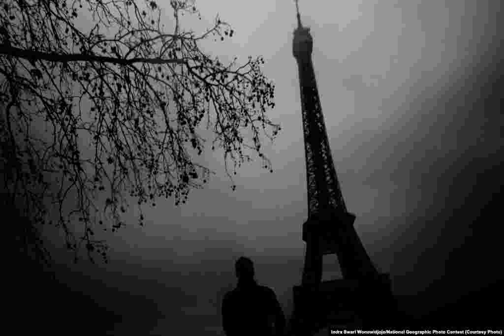HONORABLE MENTION: Eerie Eiffel (Paris, France) -- The winter gloomy day worked to my advantage to create this eerie feeling of the famous landmark Eiffel Tower. (Caption by photographer Indra Swari Wonowidjojo)