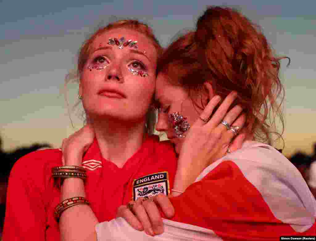 England soccer fans in London's Hyde Park react to their team's loss to Croatia at the World Cup on July 11. (Reuters/Simon Dawson)