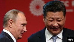 Chinese President Xi Jinping (right) and Russian President Vladimir Putin