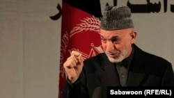 Afghan President Hamid Karzai claims Taliban attacks aid those who argue foreign troops are needed in Afghanistan.