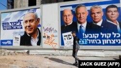 Իսրայել - Բենյամին Նեթանյահուի և Բենի Գանցի դիմանկարներով նախընտրական պաստառները Թել Ավիվում, ապրիլ, 2019թ․