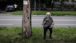 A woman waits for a health check in front of a COVID-19 medical center in Belgrade on July 2.