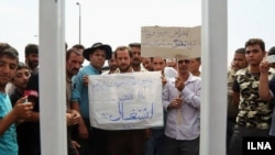 Vendors in the city of Qom gathering in front of governor's office in protest to death of a vendor, on Sunday August 13, 2017.