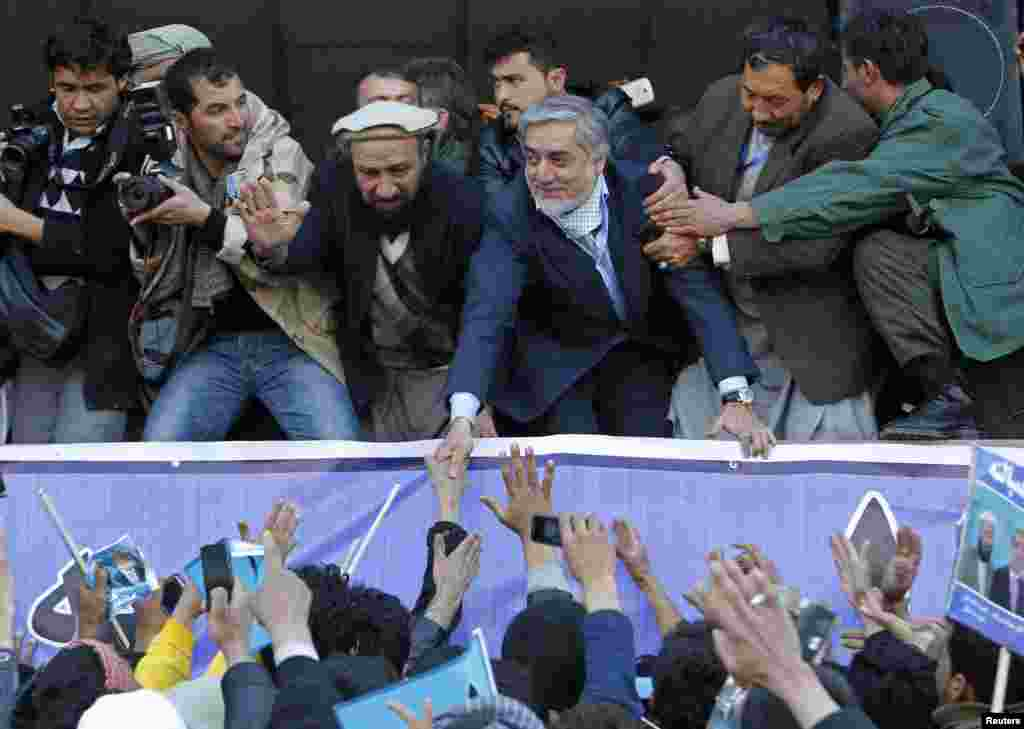 Afghan presidential candidate Abdullah Abdullah (center) shakes hands with his supporters during an election campaign rally in Kabul on February 27. (Reuters/Omar Sobhani)