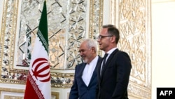 Iran's Foreign Minister Mohammad Javad Zarif (L) receives his German counterpart Heiko Maas in the capital Tehran on June 10, 2019. (Photo by ATTA KENARE / AFP)