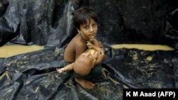 Ребенок-рохинджа, прибывший из Мьянмы в лагерь для беженцев в городе Текнаф, Бангладеш, 5 сентября 2017 года