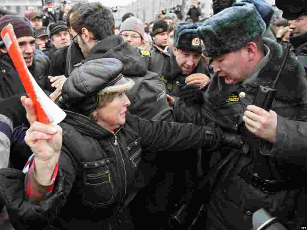 Police officers scuffled with protesters in Moscow.