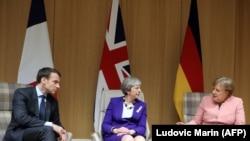 Франция президенти Эммануэл Макрон, британ премьери Тереза Мэй жана немис канцлери Ангела Меркел. Брюссель. 22-март, 2018-жыл.