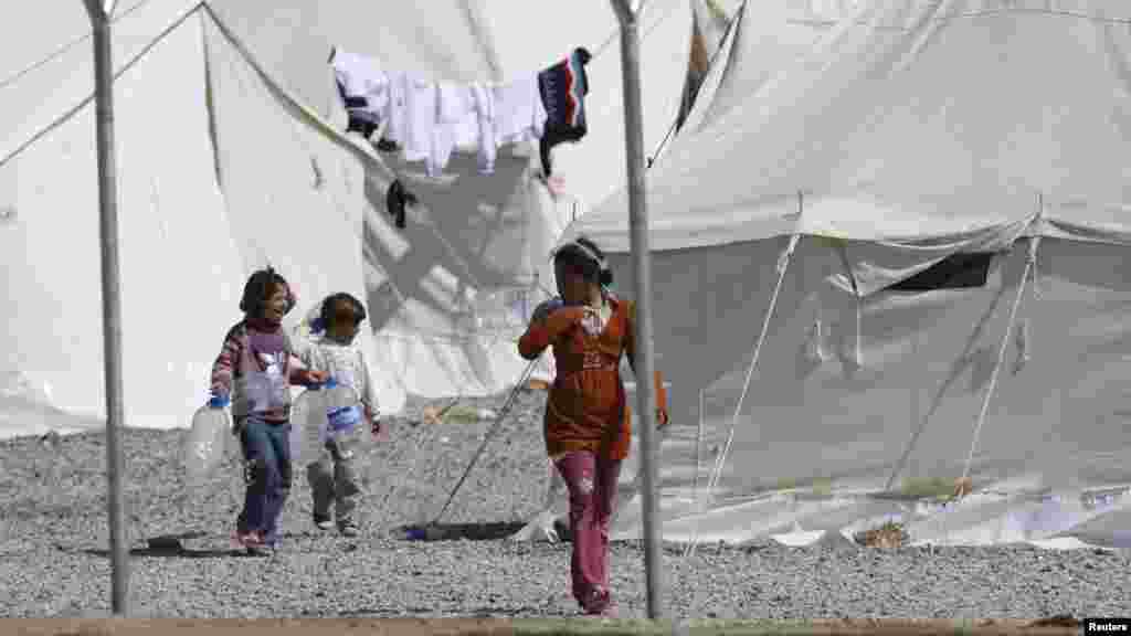 Syrian refugees stroll at the Islahiye refugee camp in Gaziantep, Turkey.