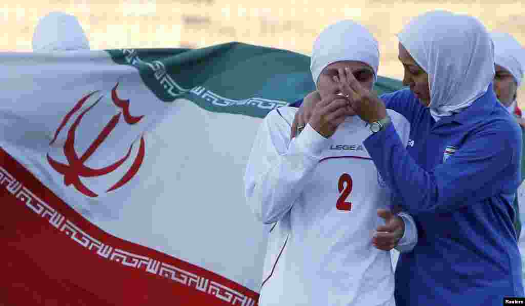 Iranian women's national soccer team players react after withdrawing from a qualifying match against Jordan for the 2012 London Olympic Games in Amman in June 2011 over FIFA's rules on head coverings.