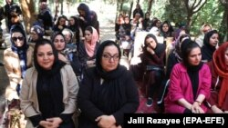 Afghan women attending an event to launch the My Red Line campaign in Herat on August 1.