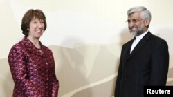 Iran's chief nuclear negotiator Said Jalili (right) and European Union foreign policy chief Catherine Ashton before talks in Almaty on April 5.
