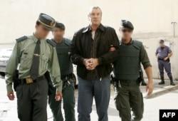 Геннадия Петрова ведут в суд в Пальма-де-Майорка