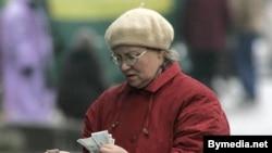 Belarus -- woman in Minsk street holds money, 28Feb2008
