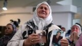 BOSNIA-HERZEGOVINA -- A woman reacts during the live transmission of the judges verdict on former Bosnian Serb political leader Radovan Karadzic's appeal of his 40 year sentence for war crimes, in the Memorial center Potocari near Srebrenica, March 20, 20