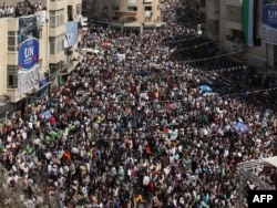 Палестина аны күнкорсуз мамлекет деп таанып, БУУга мүчө кылып кабыл алууну сурап арыз берүүсүн колдогон демонстрация. Батыш Иордандын Рамалла шаары. 21-сентябрь 2011