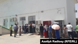 People in Ashgabat wait in line to buy food in a state shop.