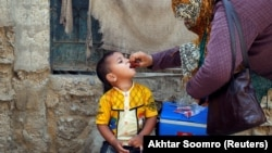 A boy receives polio vaccine drops during an anti-polio campaign in a low-income neighborhood in Karachi on April 9.