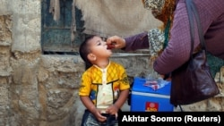 A boy receives polio vaccine drops during an antipolio campaign in Karachi in April.
