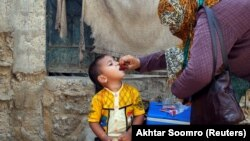A boy receives polio-vaccine drops during an immunization campaign in Karachi.
