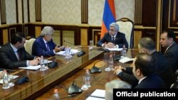 Armenia -- President Serzh Sarkisian meets with the members of a presidential commission on constitutional reform, 24 June, 2014.