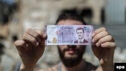 Башар Асаддын элеси Сирия акчасына чегерилген