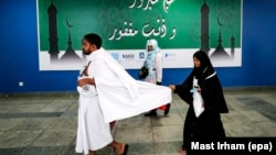 Muslim worshippers arrive at the hajj terminal of the King Abdulaziz international airport in Jeddah on August 27.
