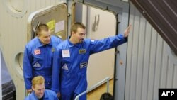 Members of the Mars500 crew smile for the press before being locked into an isolation facility in Moscow at the start of their mission last year.