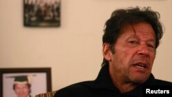Pakistan - Imran Khan, Pakistani cricketer-turned-politician and chairman of the Pakistan Tehreek-e-Insaf (PTI) political party, speaks during an interview with Reuters at his office in Islamabad November 8, 2013.