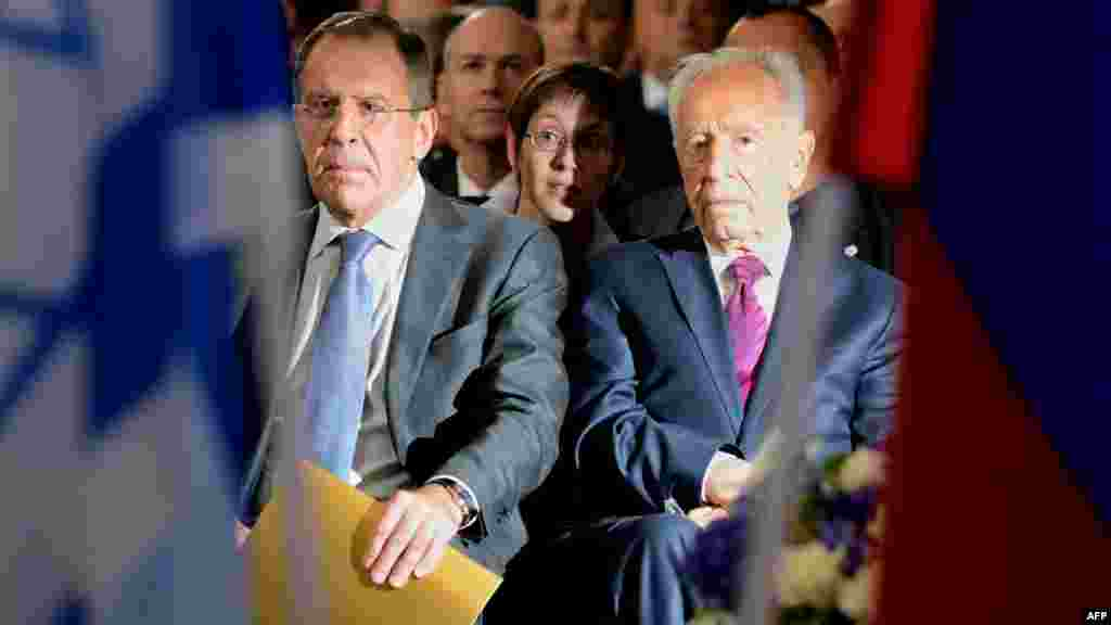 Russian Foreign Minister Sergei Lavrov and Israeli President Shimon Peres attend the opening ceremony.