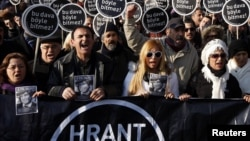 "Turkey - Friends of slain Turkish-Armenian journalist Hrant Dink march with placards that read: ""This case won't end this way"" during a demonstration near a courthouse in Istanbul, 17Jan2012."