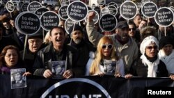 "Friends of slain Turkish-Armenian journalist Hrant Dink march with placards that read: ""This case won't end this way,"" during a demonstration near a courthouse in Istanbul on January 17."