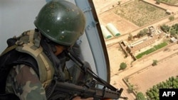 A Yemeni soldier sitting inside a helicopter as it patrols over a rebel stronghold (file photo)