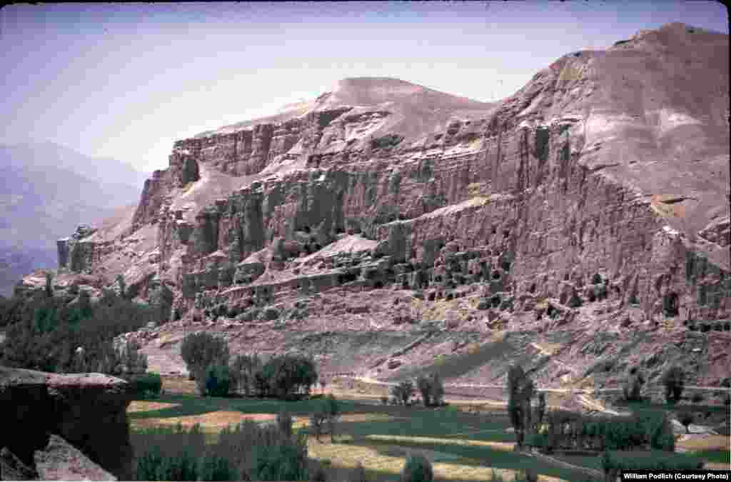 "The Bamiyan Valley, home to giant Buddha statues that were destroyed by the Taliban in 2001. ""That was a bumpy, rough trip,"" recalls Peg Podlich, ""but I'll never forget how wide and green the valley was or how monumental those two Buddha statues were, carved into the face of the cliff.... The statues were a magnificent sight, even to someone like me who did not really understand the history or technical achievement of those statues."""