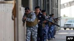 Pjesëtarët e forcave të sigurisë së Irakut gjatë një operacioni