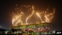 The closing ceremony of the 2008 Olympic Games in Beijing -- a massive demonstration of Chinese wealth and power.