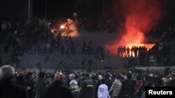 Soccer fans flee from violence at Port Said's stadium on February 1.