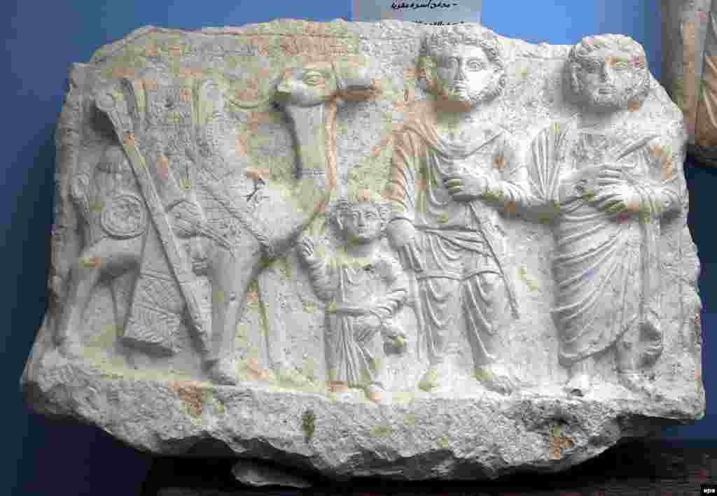 From the same dig - the scene depicts two Palmyrian merchants and a child standing next to a camel.