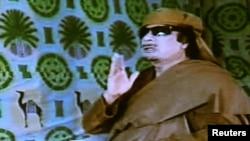Мөәммәр Каддафи. 15 мартта телевидениедән чыгыш ясый.