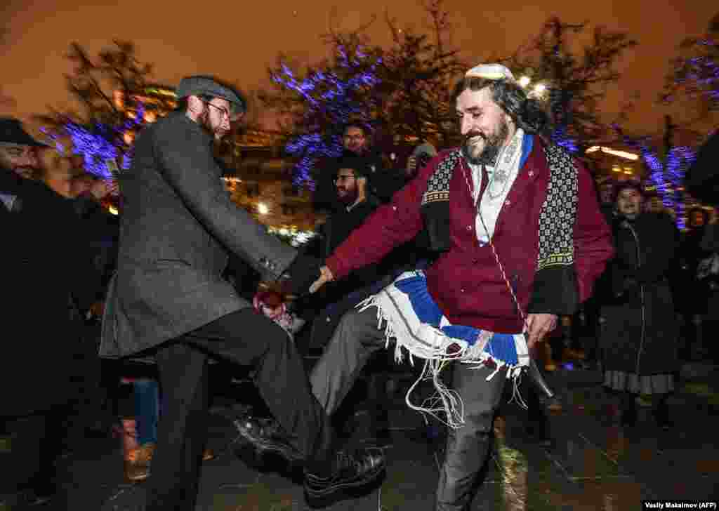 Jewish people dance during Hanukkah celebrations in central Moscow on December 12.  (AFP/Vasily Maximov)