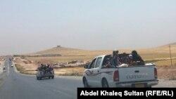 Курды покидают захваченные города Зумар и Синджар, 3 августа 2014 года.